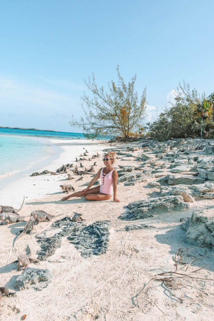 A woman hanging out with the iguanas at Leaf Cay