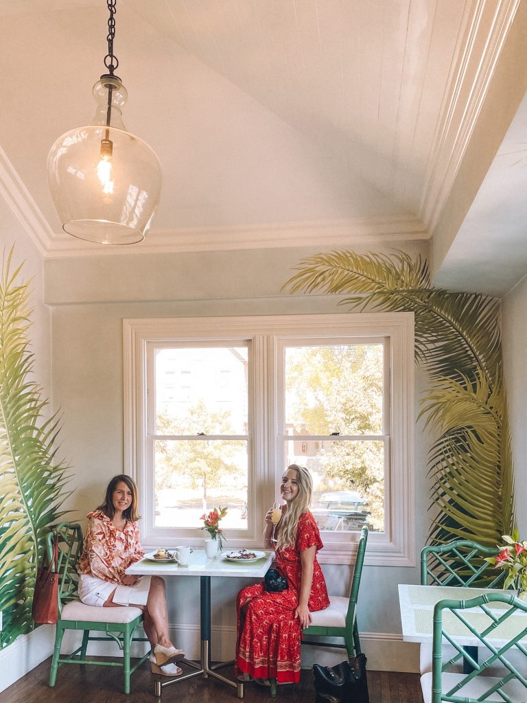 A mother and daughter enjoying brunch at The George in Napa during a California Wine Country road trip.