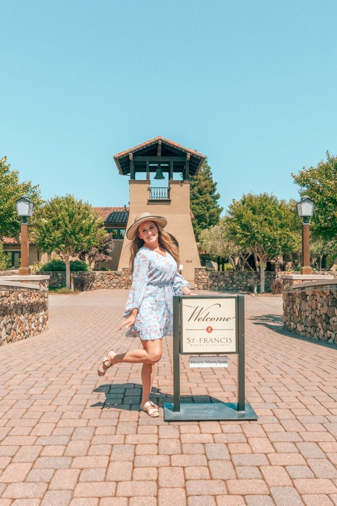 A woman at St. Francis Winery during a California Wine Country road trip