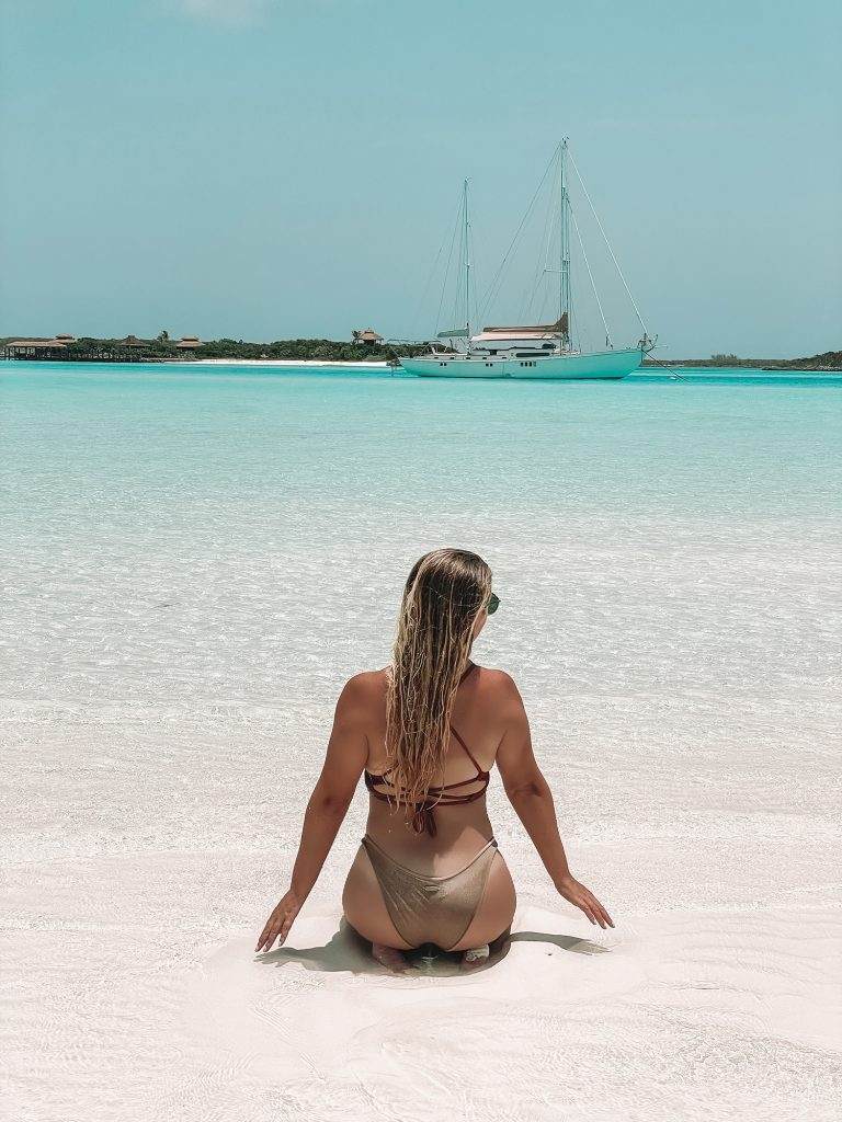 A woman relaxing at a sand bar in Exuma, Bahamas from Staniel Cay