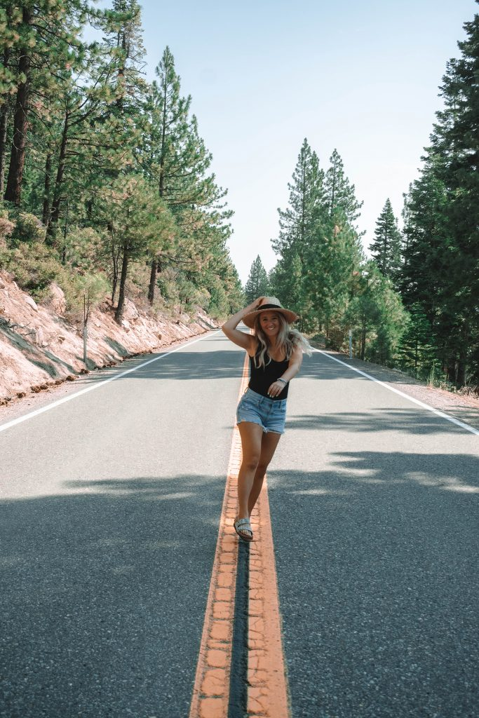 A woman skipping down a street in Lake Tahoe