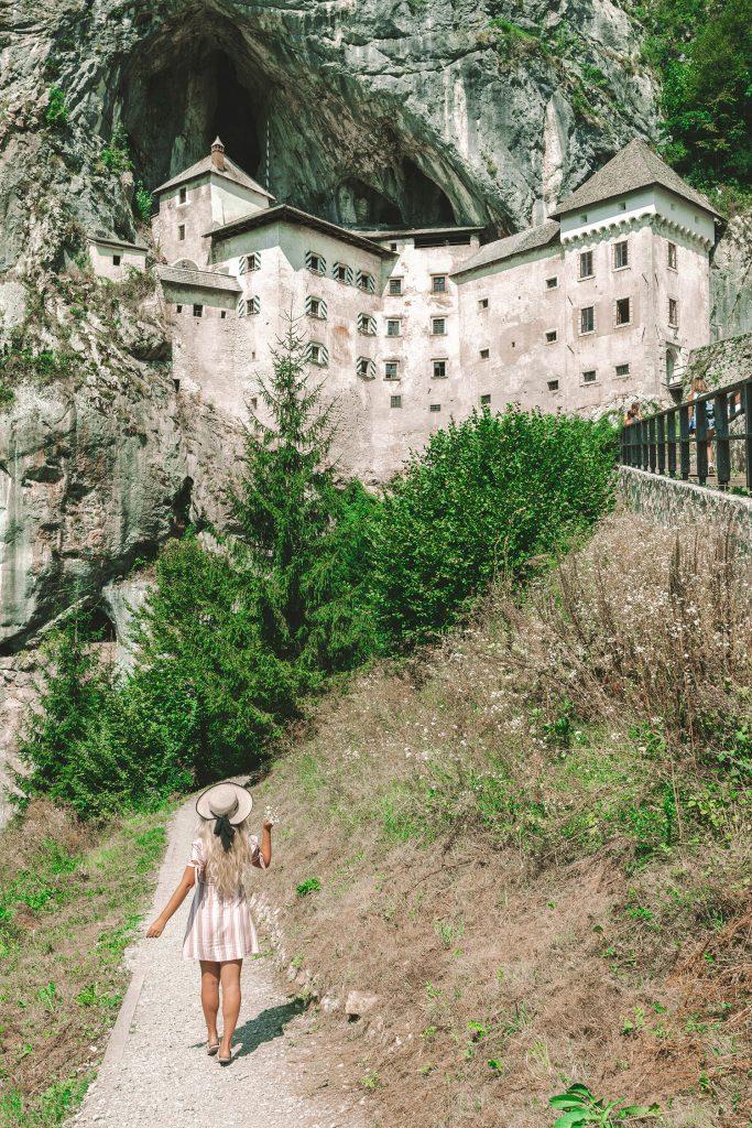 A woman at Predjama Castle