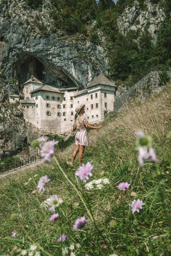 A woman at Predjama Castle during a weekend in Slovenia