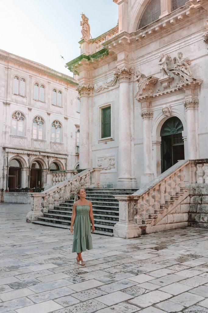 A woman walking in Loggia Square in Dubrovnik, Croatia