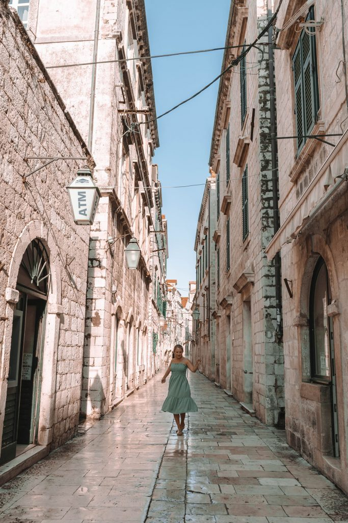 A woman walking the streets of Old Town Dubrovnik
