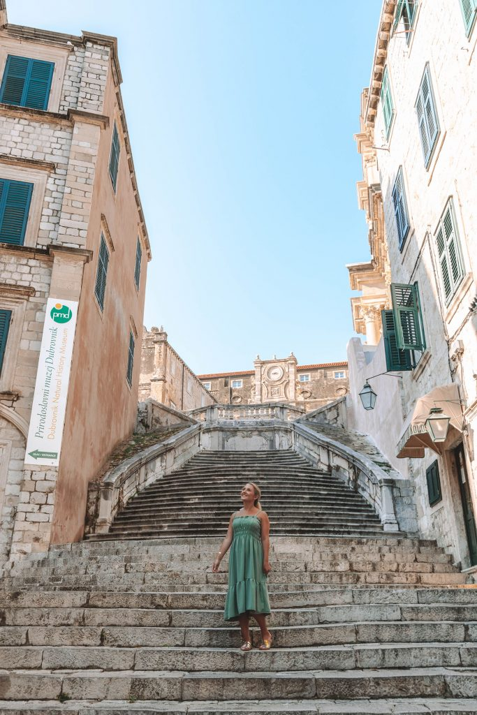 A woman walking the Jesuit Stairs in Old Town Dubrovnik
