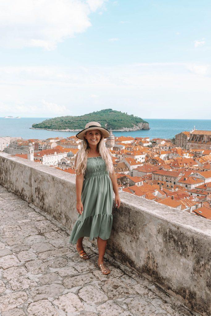 A woman walking the city walls of Dubrovnik - a bucket list goal