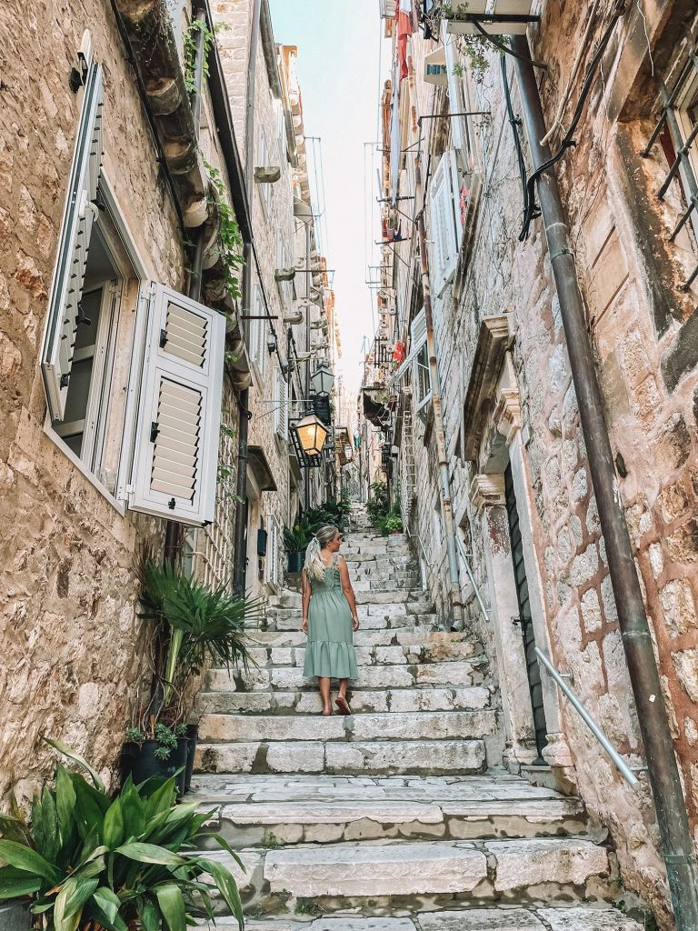 A woman strolling the beautiful streets of Old Town Dubrovnik