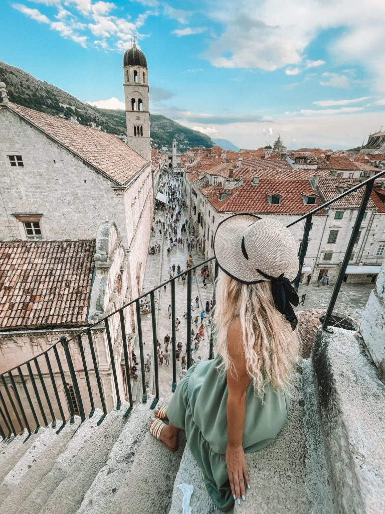 A woman on the ancient city walls of Dubrovnik