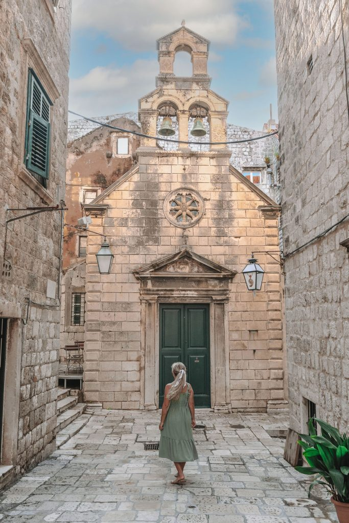 A woman walking around Old Town Dubrovnik - a bucket list goal