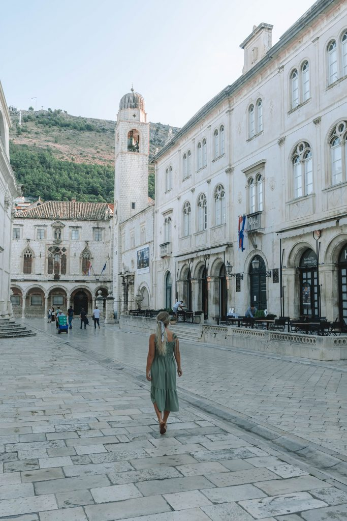 A woman strolling around Old Town Dubrovnik - a bucket list goal