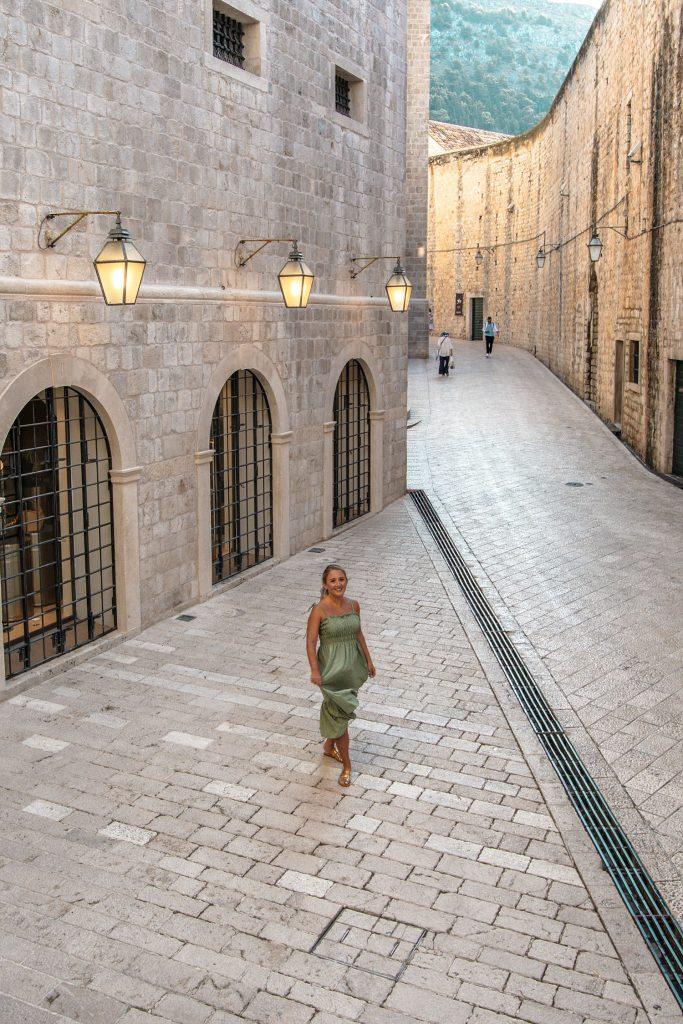 A woman crossing off bucket list activities in Dubrovnik