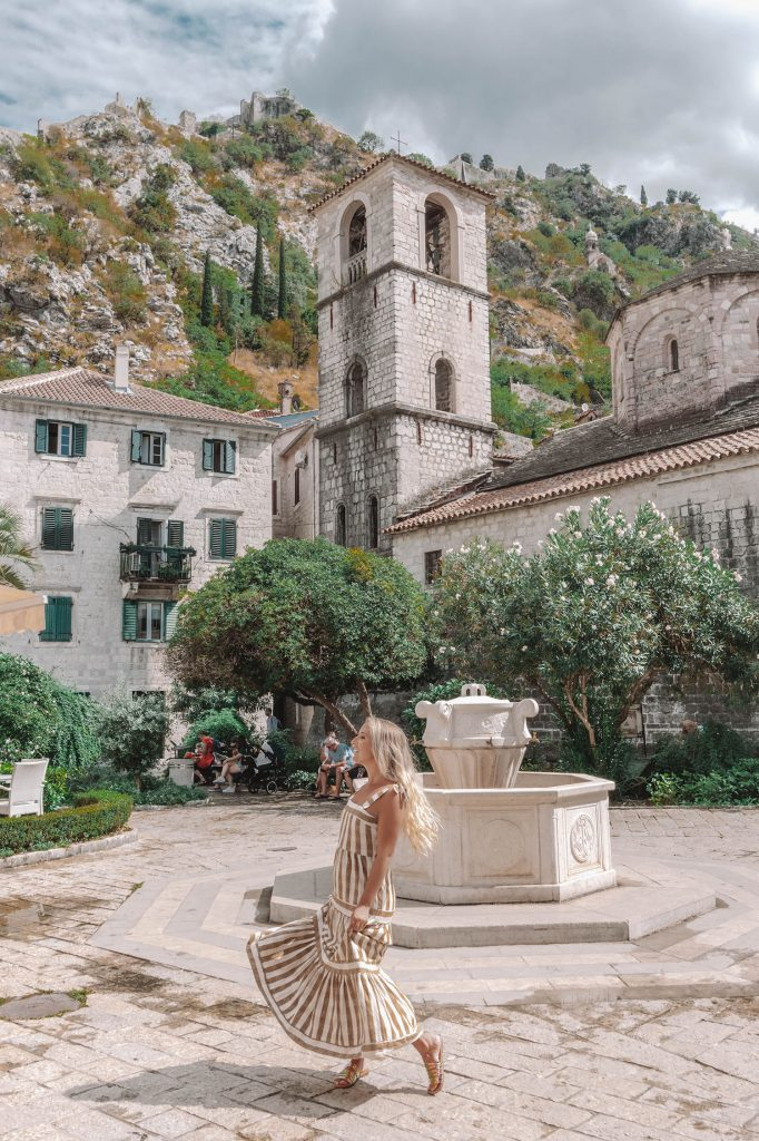 A woman visiting Kotor, Montenegro - a Dubrovnik bucket list day trip