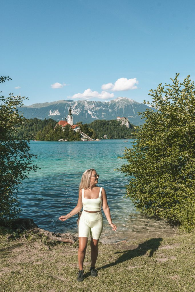 A woman enjoying her time at Lake Bled during a weekend in Slovenia