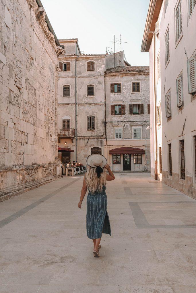 A woman exploring the Istria town of Pula, Croatia